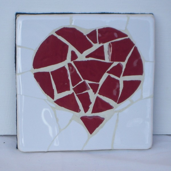 Mopsaic coaster with a red heart shaped motif.