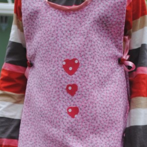 Handmade child's apron with a Strawberry motif