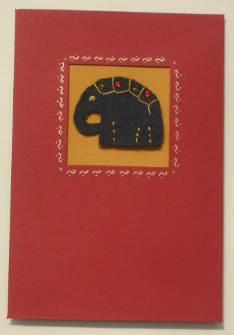 Handmade greeting card with embroidered blue felt elephant
