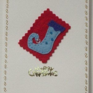 Handmade Christmas card with a blue felt Elves shoe.