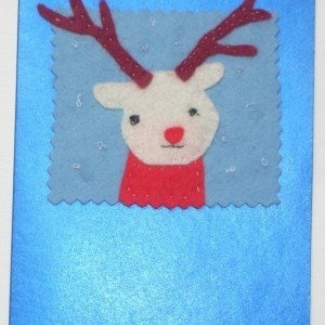 Handmade Christmas greeting card with a felt reindeer