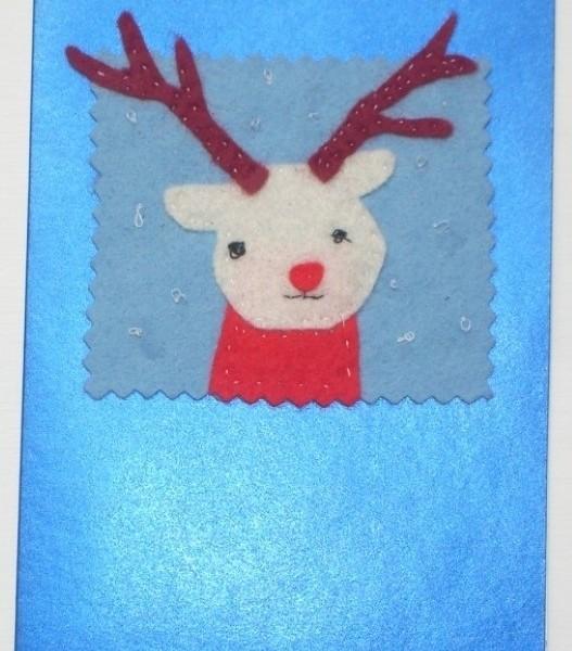 Handmade Christmas greeting card with a felt reindeer